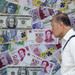 Chinese yuan seen depreciating further; rupee to remain stable: Reuters poll