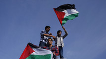U.S. would reassess aid if Hamas-PLO form government - official