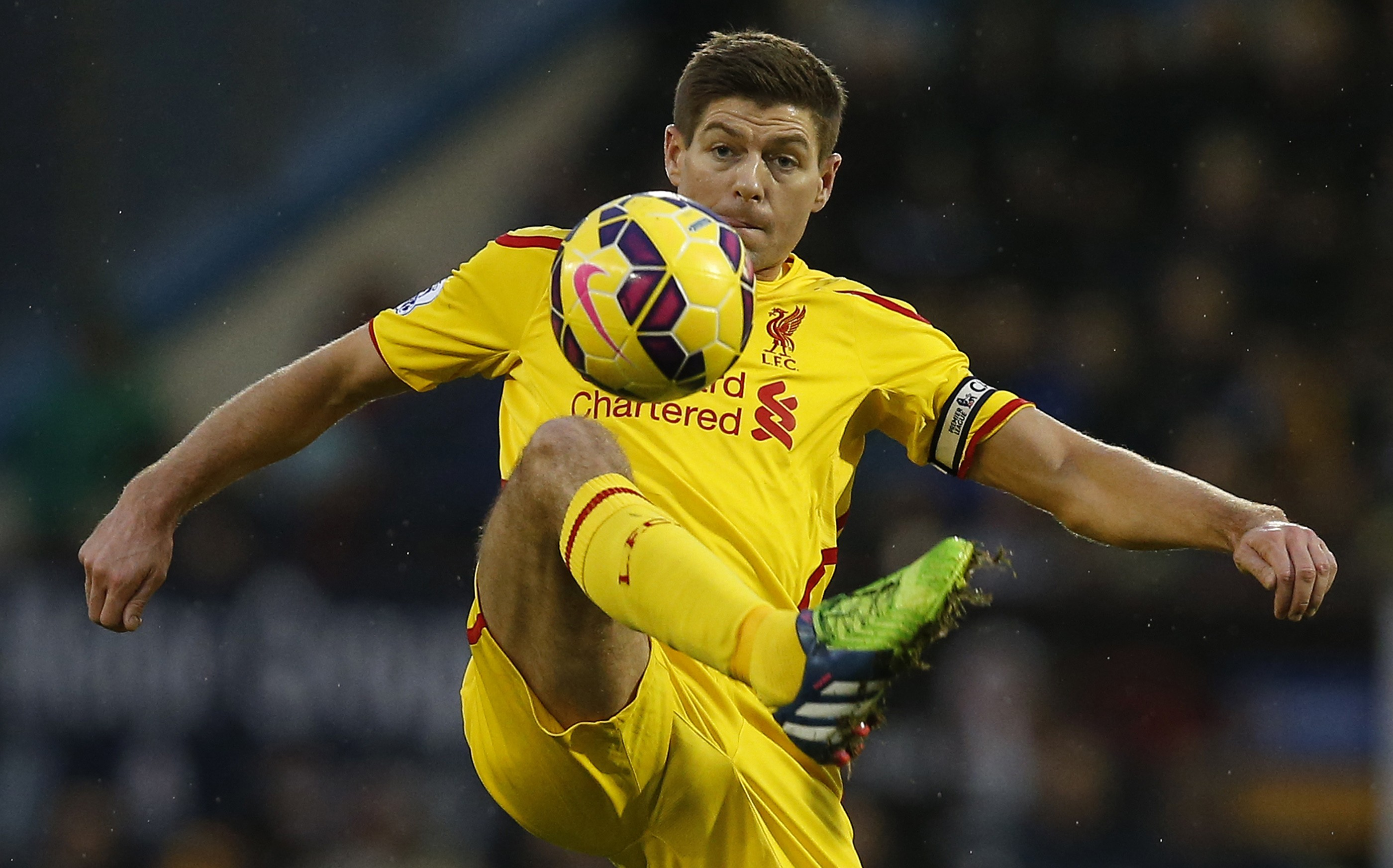 Liverpool's Steven Gerrard controls the ball during their English Premier League soccer match against Burnley at Turf Moor in Burnley