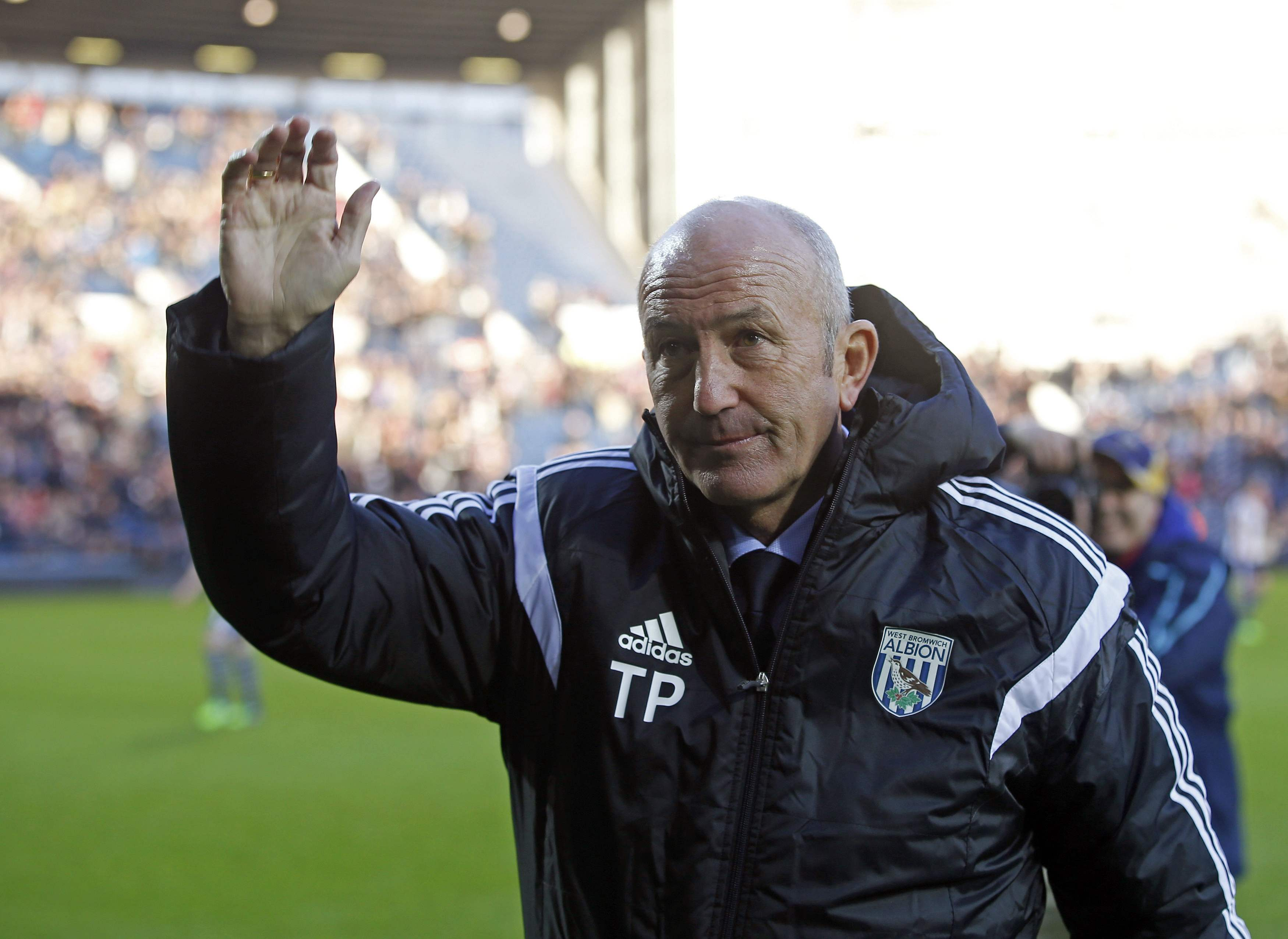 West Bromwich Albion's new manager Tony Pulis salutes the supporters before their English FA Cup third round soccer match against Gateshead in West Bromwich