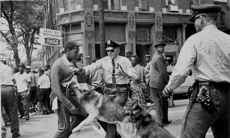 """Police Dog Attack,"" Birmingham, Ala. 1963 is on view at the High Museum. (Bill Hudson)"