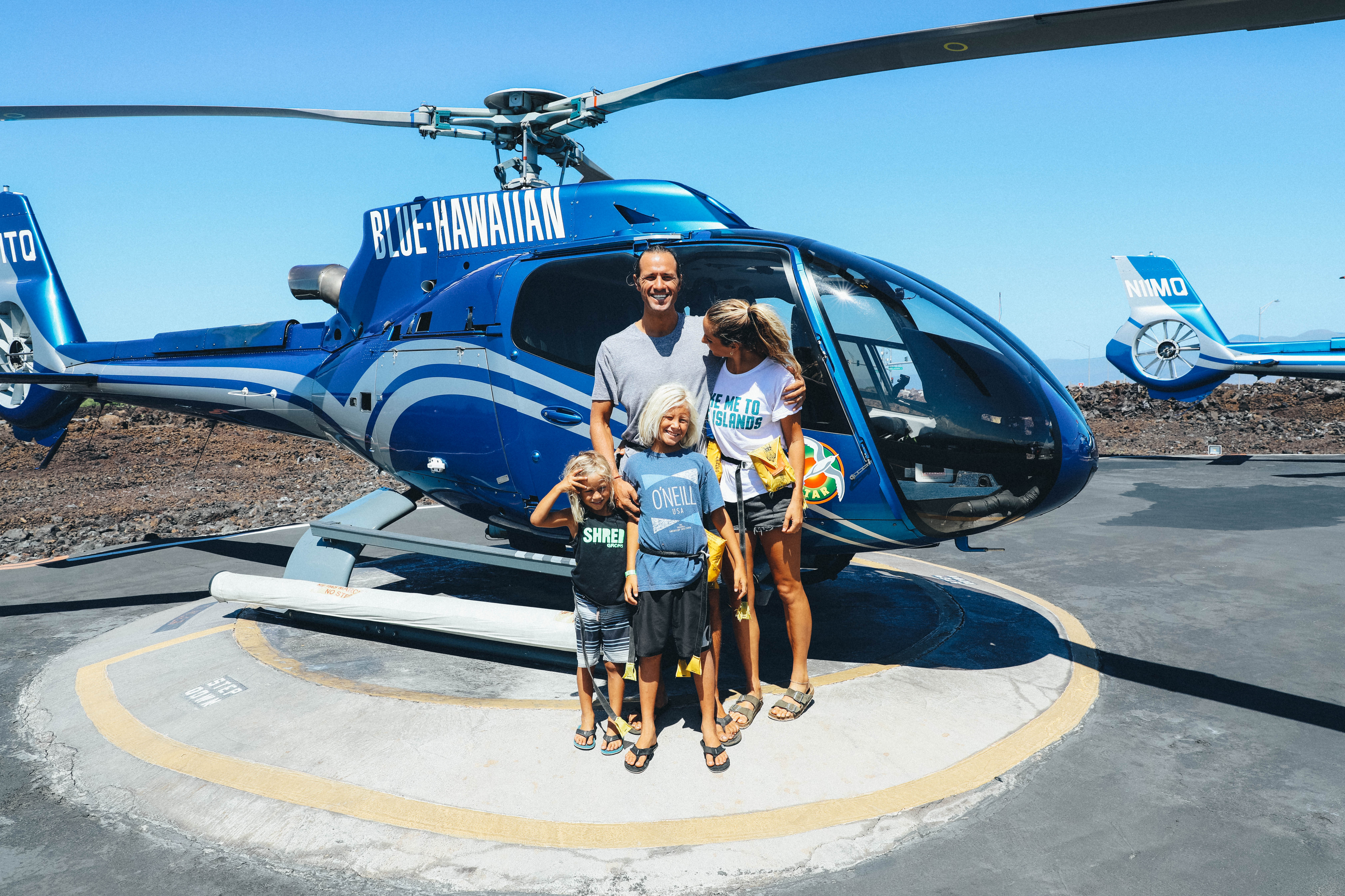 andy and family in front of helicopter for tour