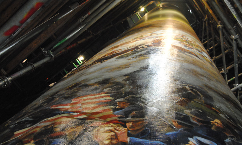 Before the massive painting could be moved, it was rolled up into a scroll.