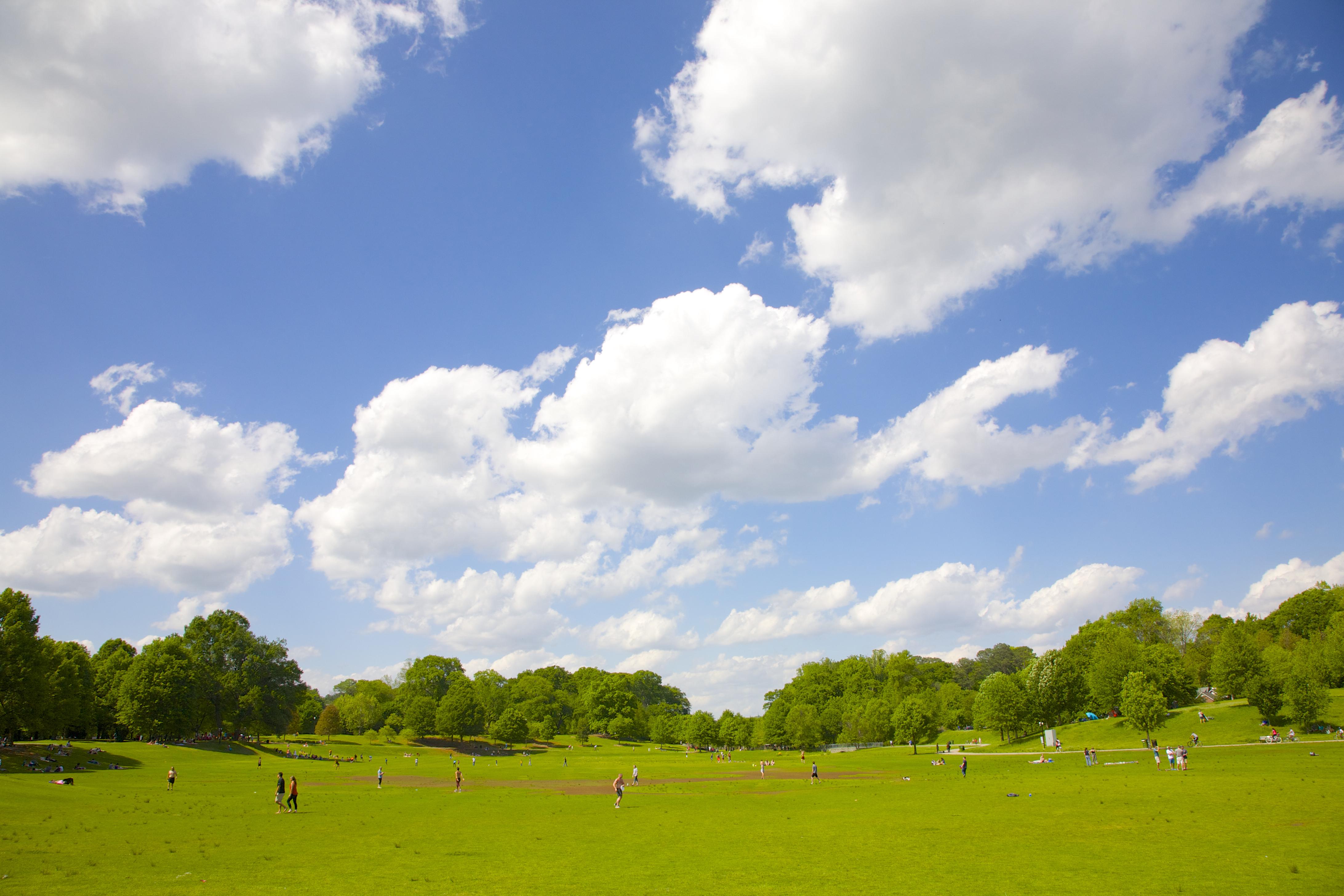 White puffy clouds atop Piedmont Park, Atlanta