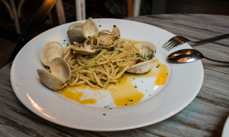 Share this clam dish and a tasty pizza pie from Ribalta with your amore.